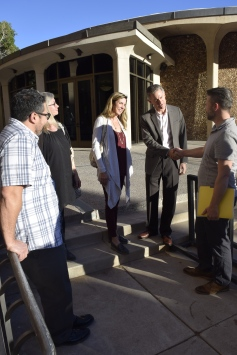 Developers Bruce and Kim Raskin meet Melrose residents who oppose their projects on the steps outside the Council Chambers Feb. 7.